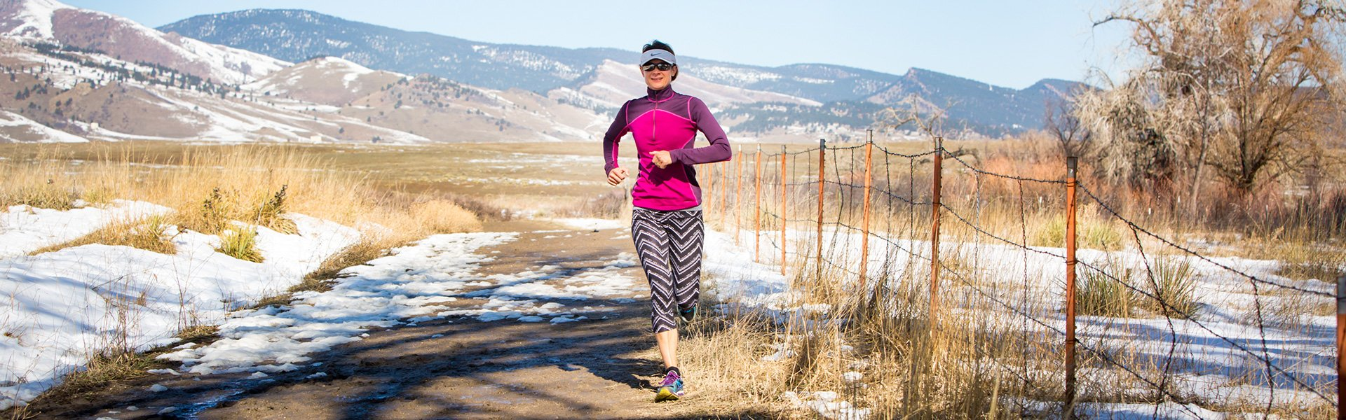Woman running on trail in Boulder Colorado