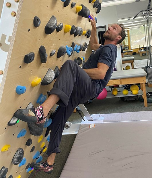 Ross climbing wall hips in