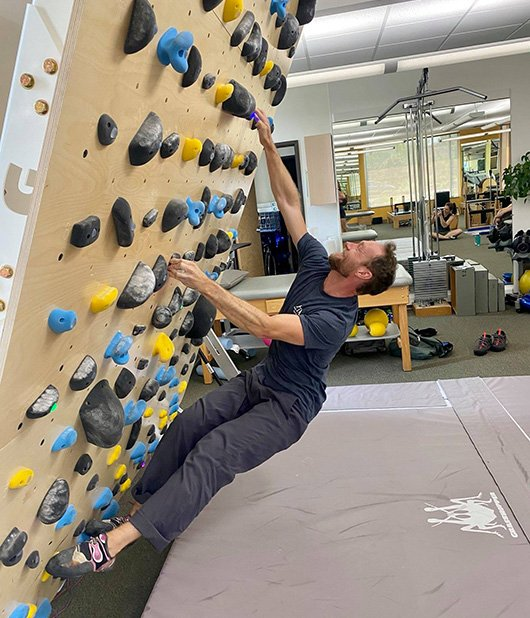 ross climbing wall showing hips out